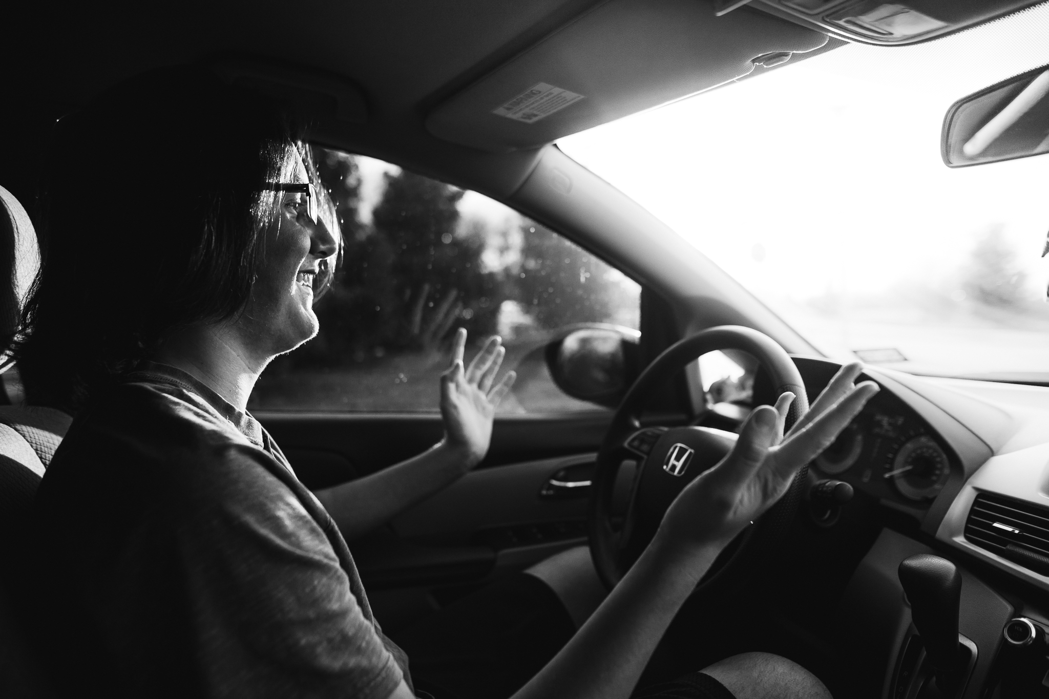 black and white photo of teenager driving kristina mccaleb