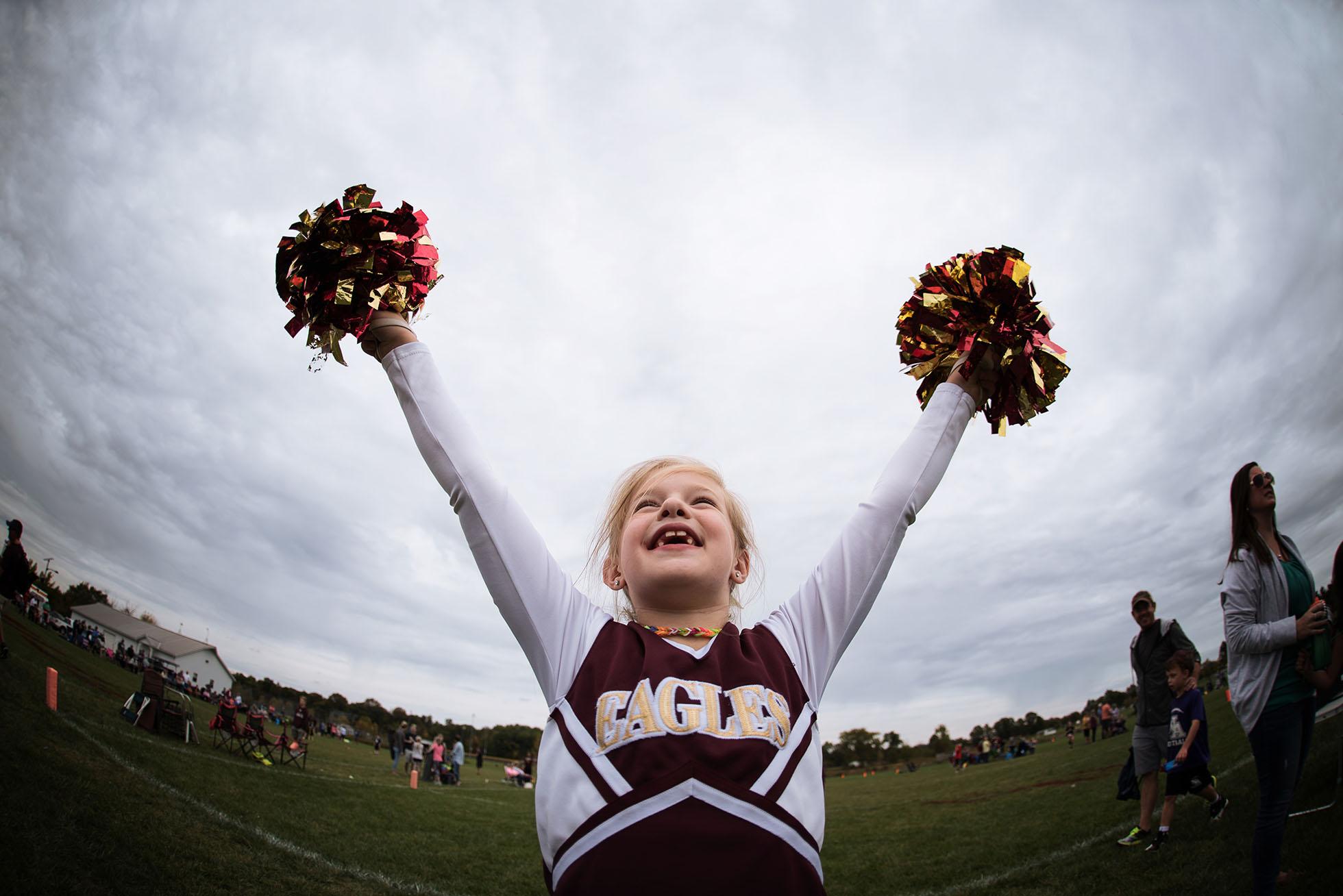 girl-cheering-at-football-game-freezing-motion-kellie-bieser