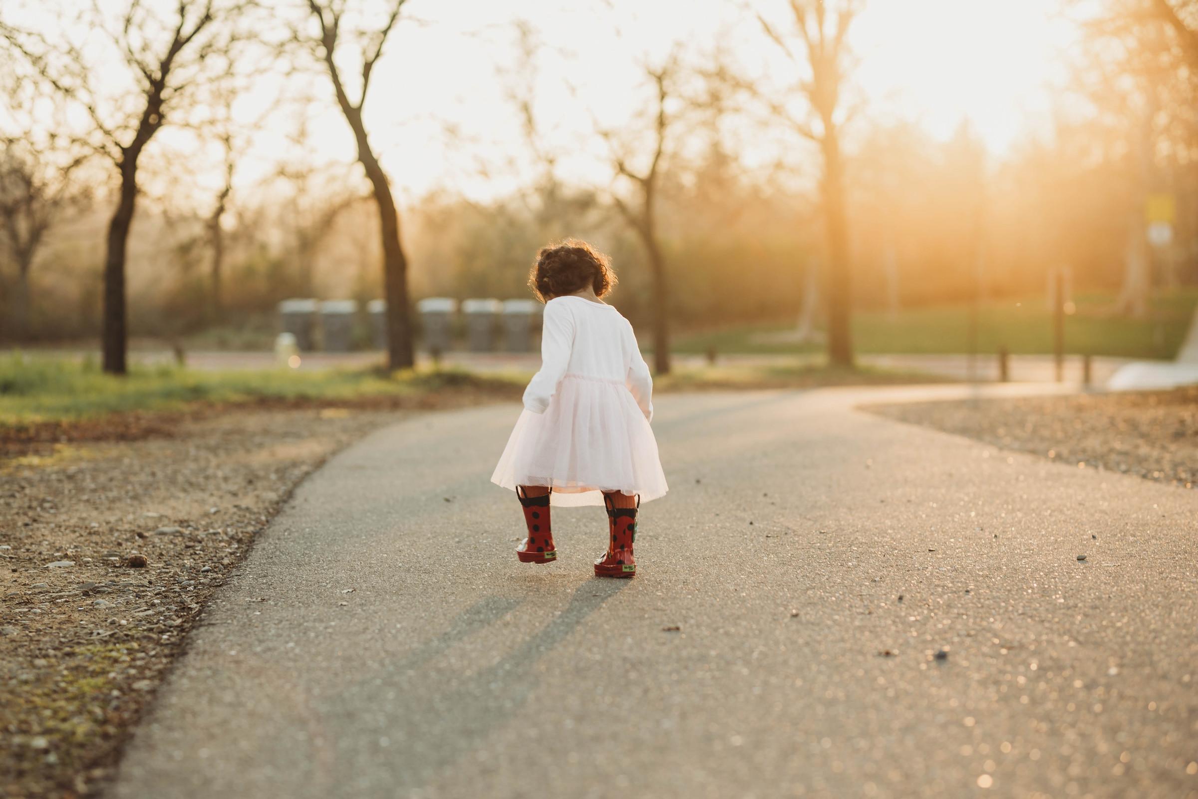 girl on path in rain boots jyo bhamadipati