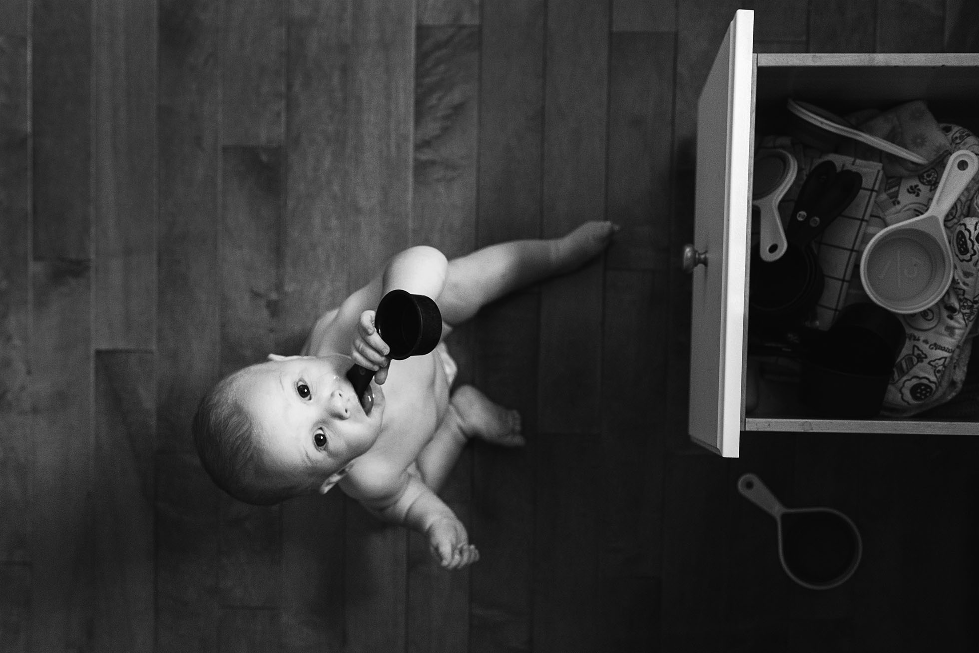 photo of toddler playing wtih kitchen utensils from above