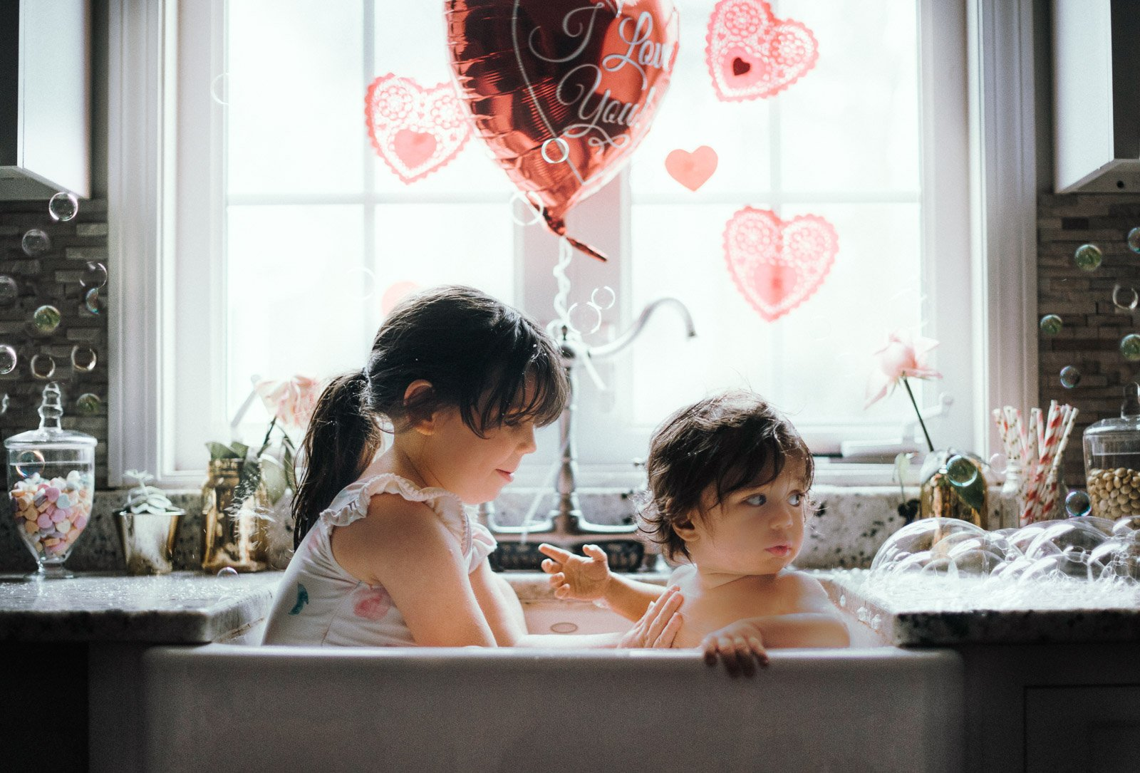 unknown-kids-in-sink-with-hearts_sfaltaous