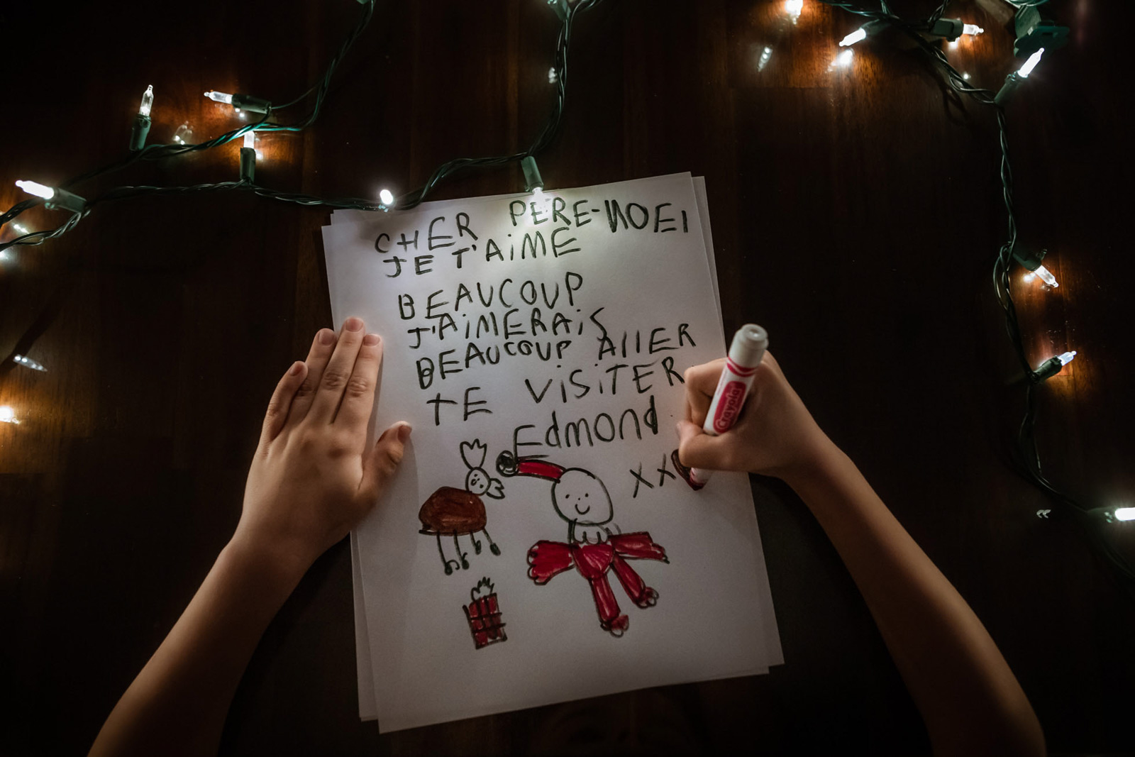 Santa Letter christmas light low hand faceless writing boy evening family photography annick paradis simon photographes quebec