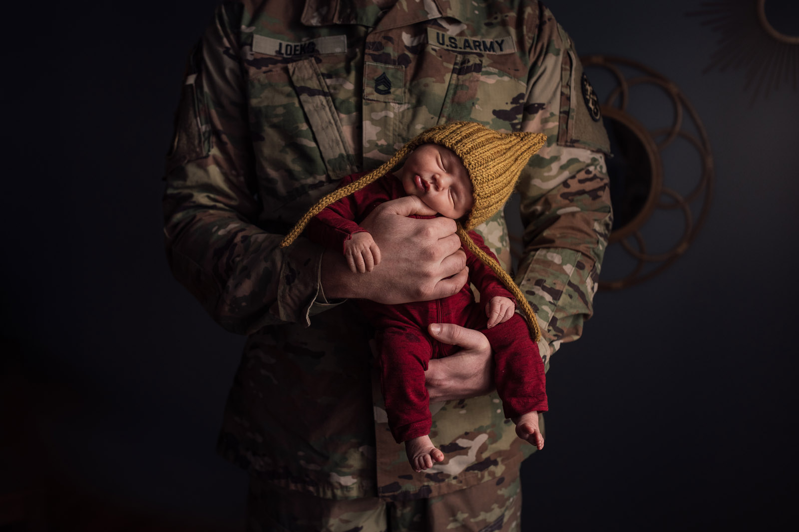 color theory man in camoflage fatigues holding infant daughter meg loeks