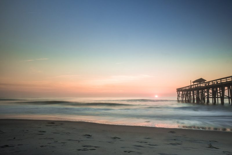 SueBahen-cm-blog-what-cm-means-to-me-sunrise-sunset-over-ocean-with-pier-and-beach