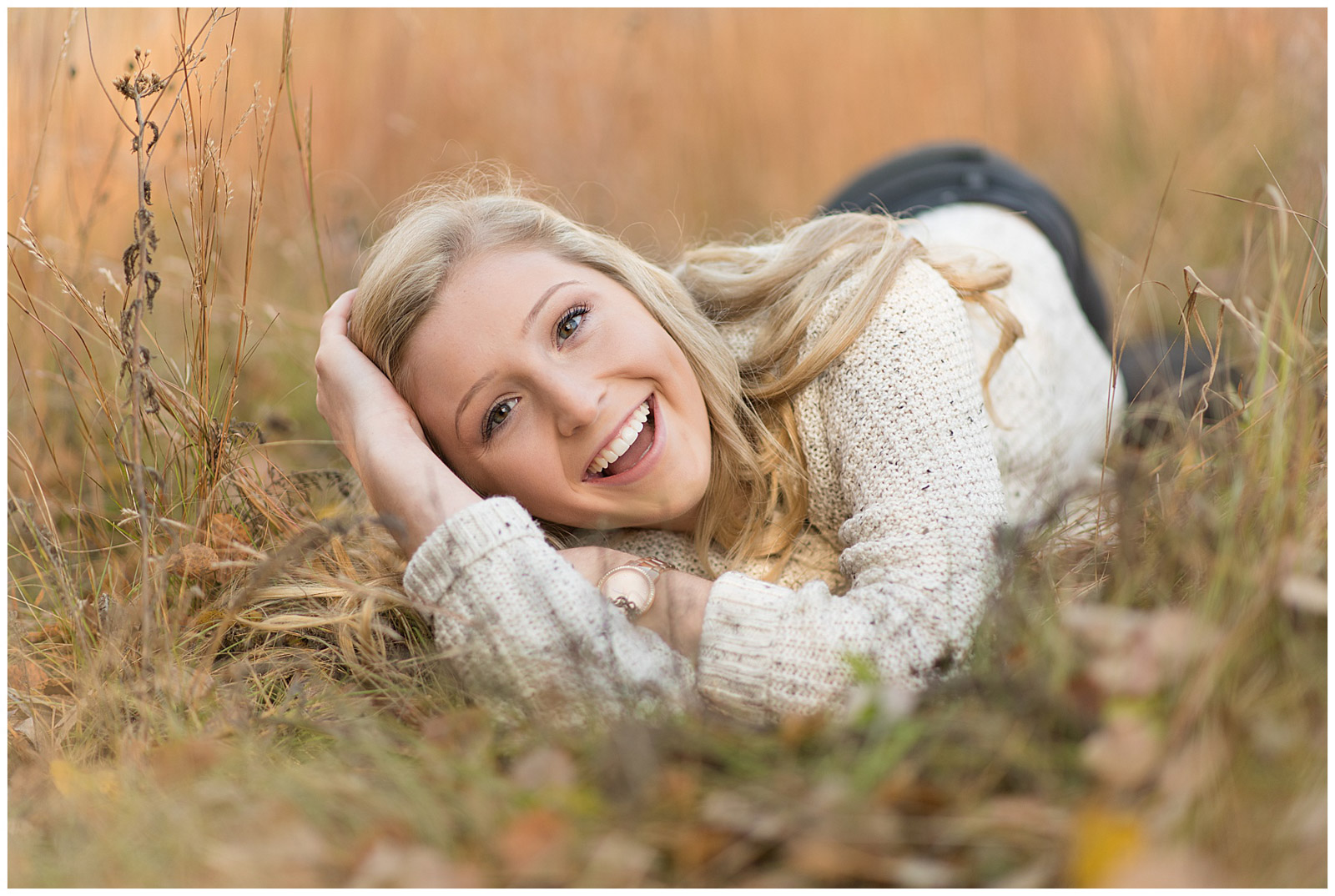 girl smiling laughing in grass outside emily and erin drew esquared photography