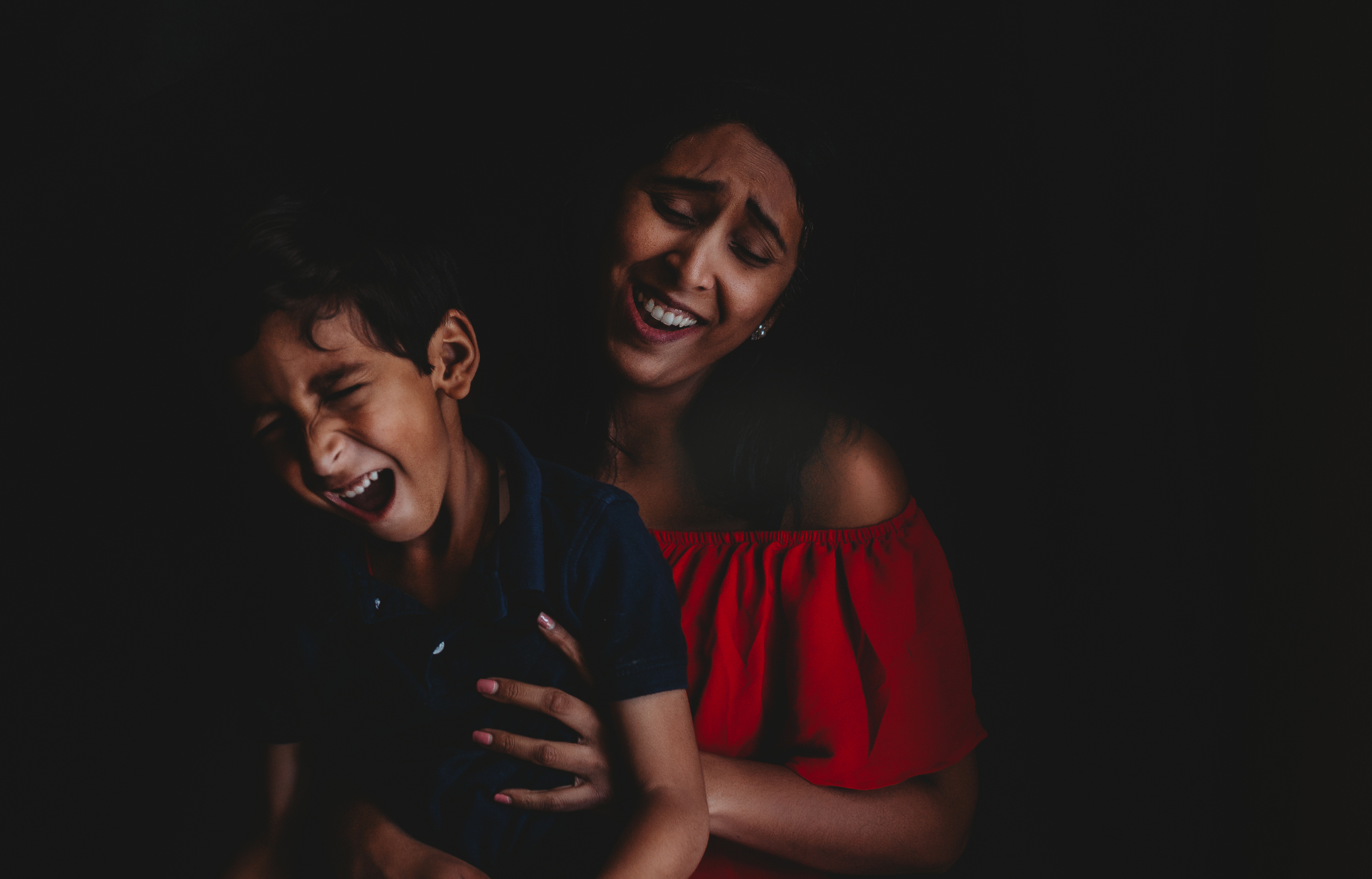 mother and young son laughing together self portrait jyo bhamidipati