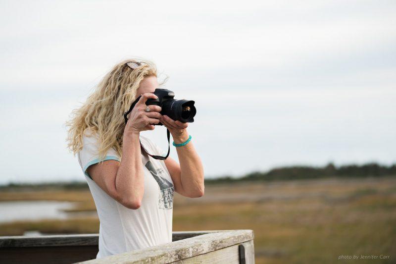 woman holding a professional camera by jennifer carr
