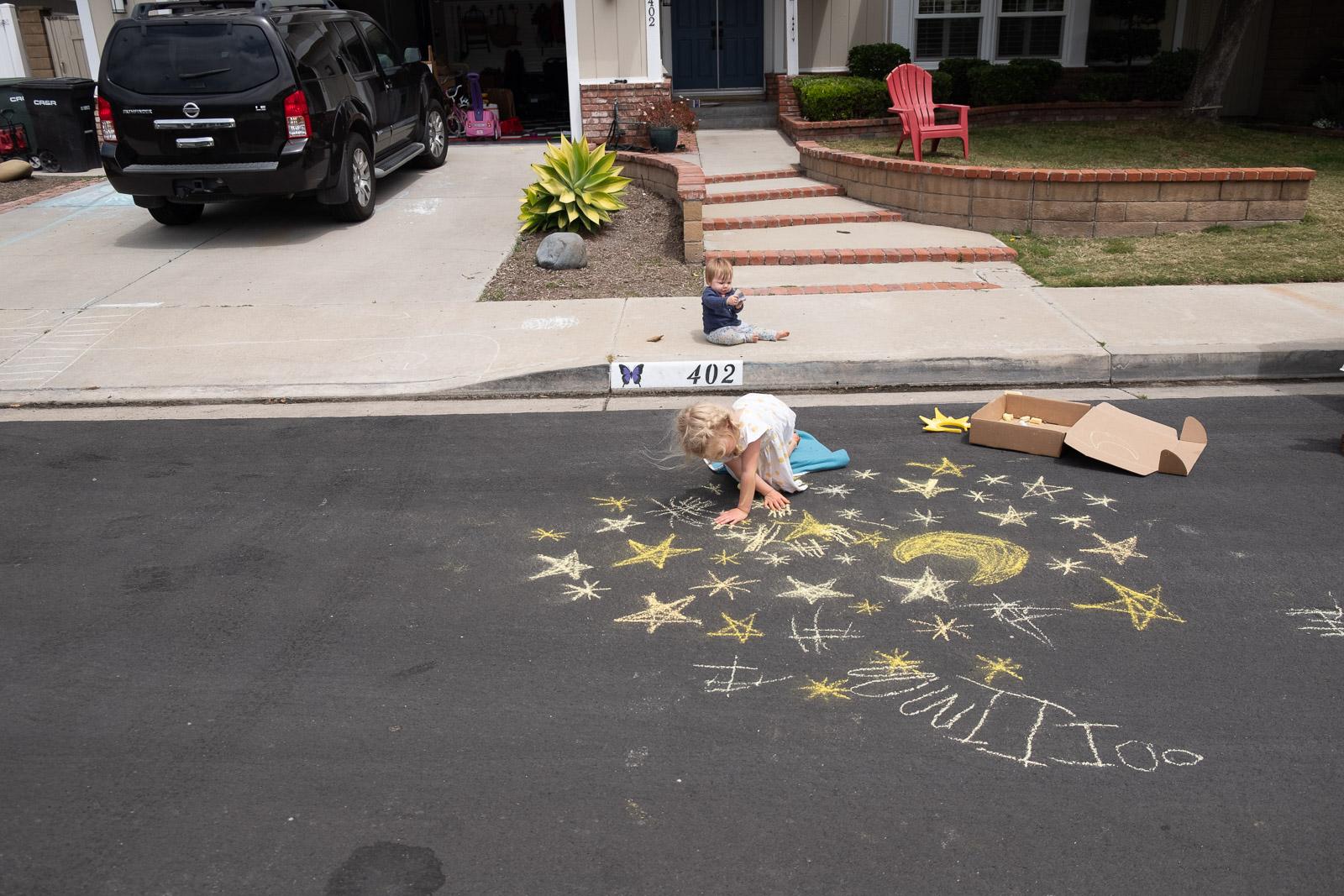 Unexpected Backdrop child drawing stars on asphalt karlee hooper
