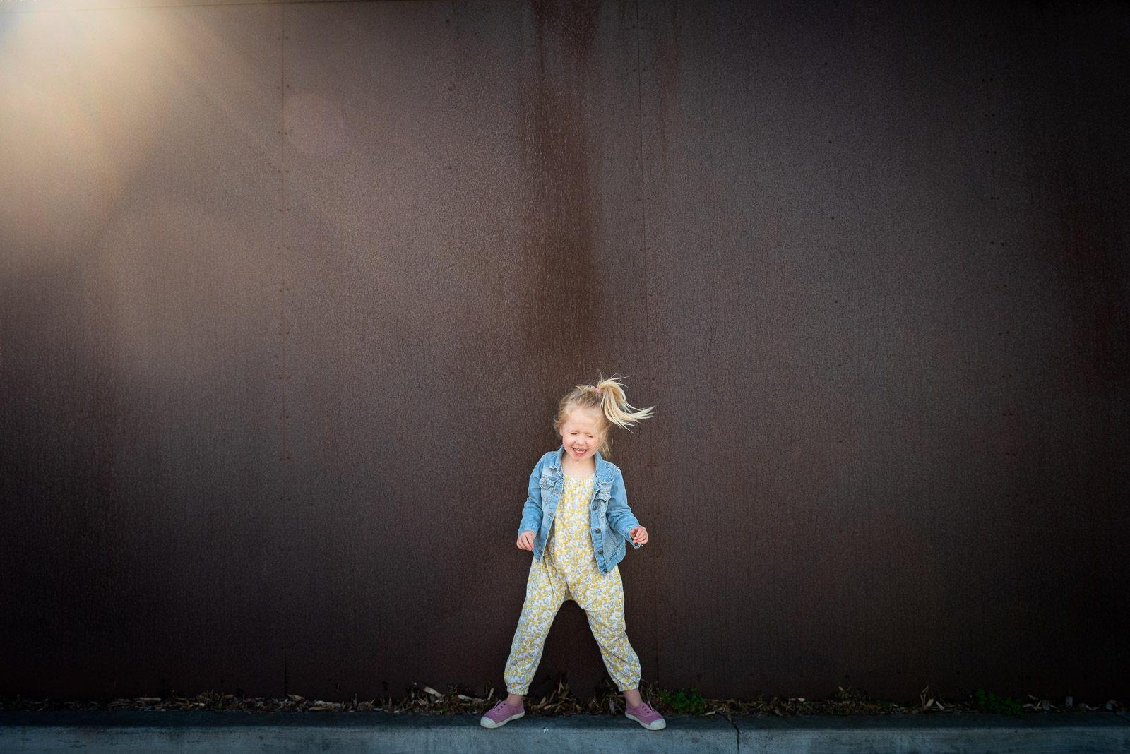 Unexpected Backdrop girl dancing in front of brown wall karlee hooper