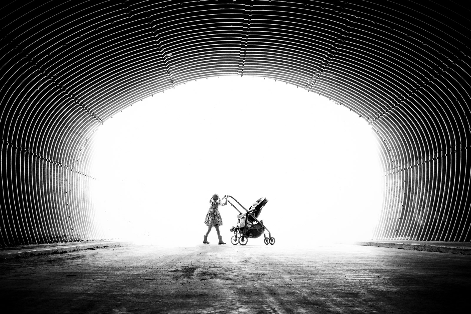 Unexpected Backdrop- girl pushing stroller in tunnel karlee hooper