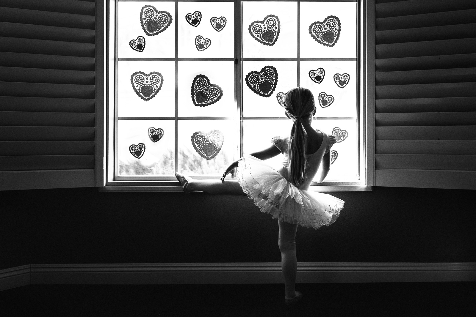 Unexpected Backdrops Window decorated with lace hearts girl in tutu black and white karlee hooper