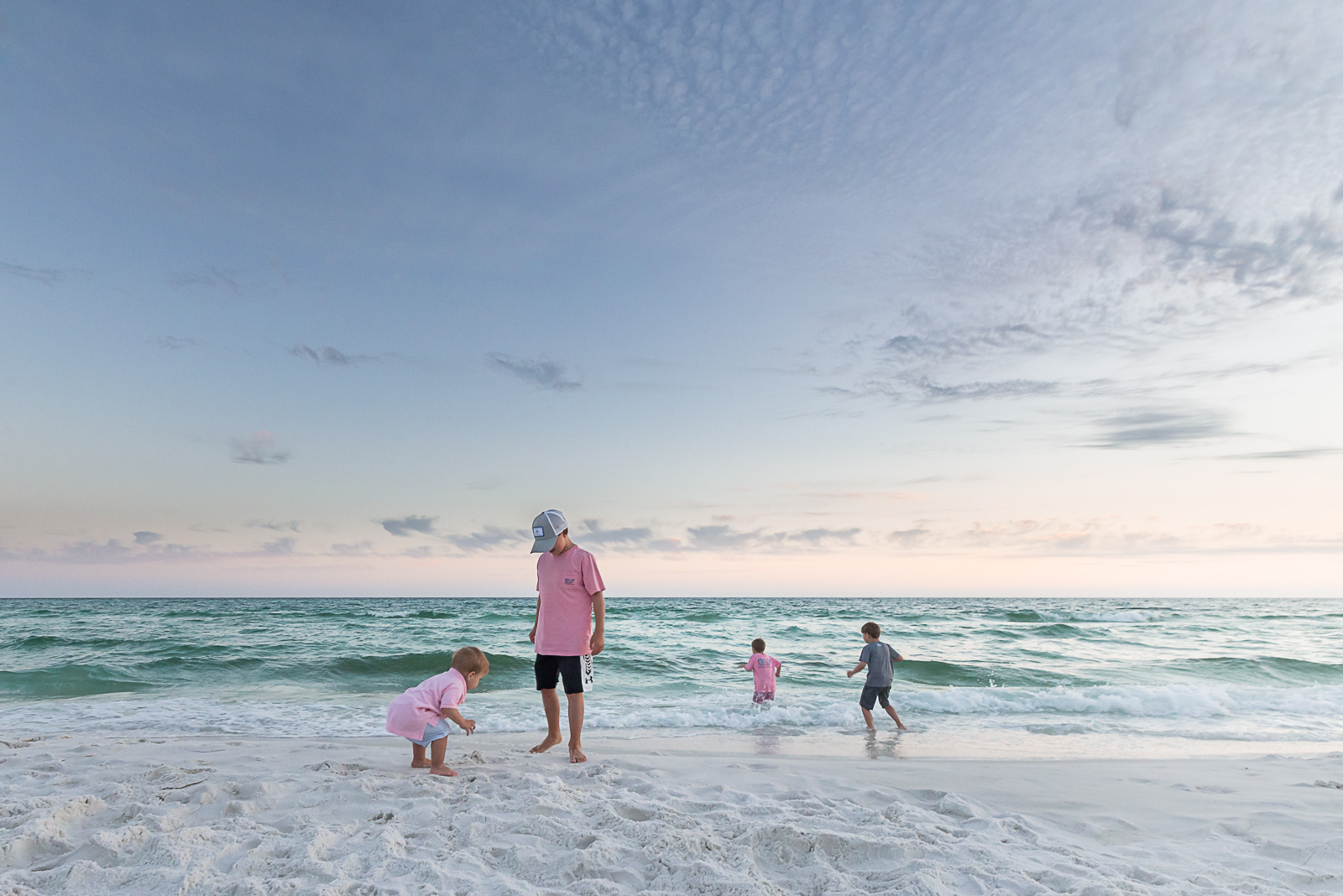 children playing in sand and water at beach megan arndt clickin moms member story