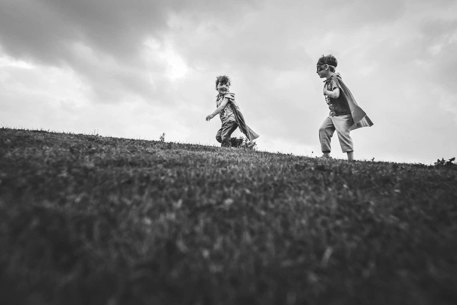 kids running outside with capes and masks superheroes myriam cobb