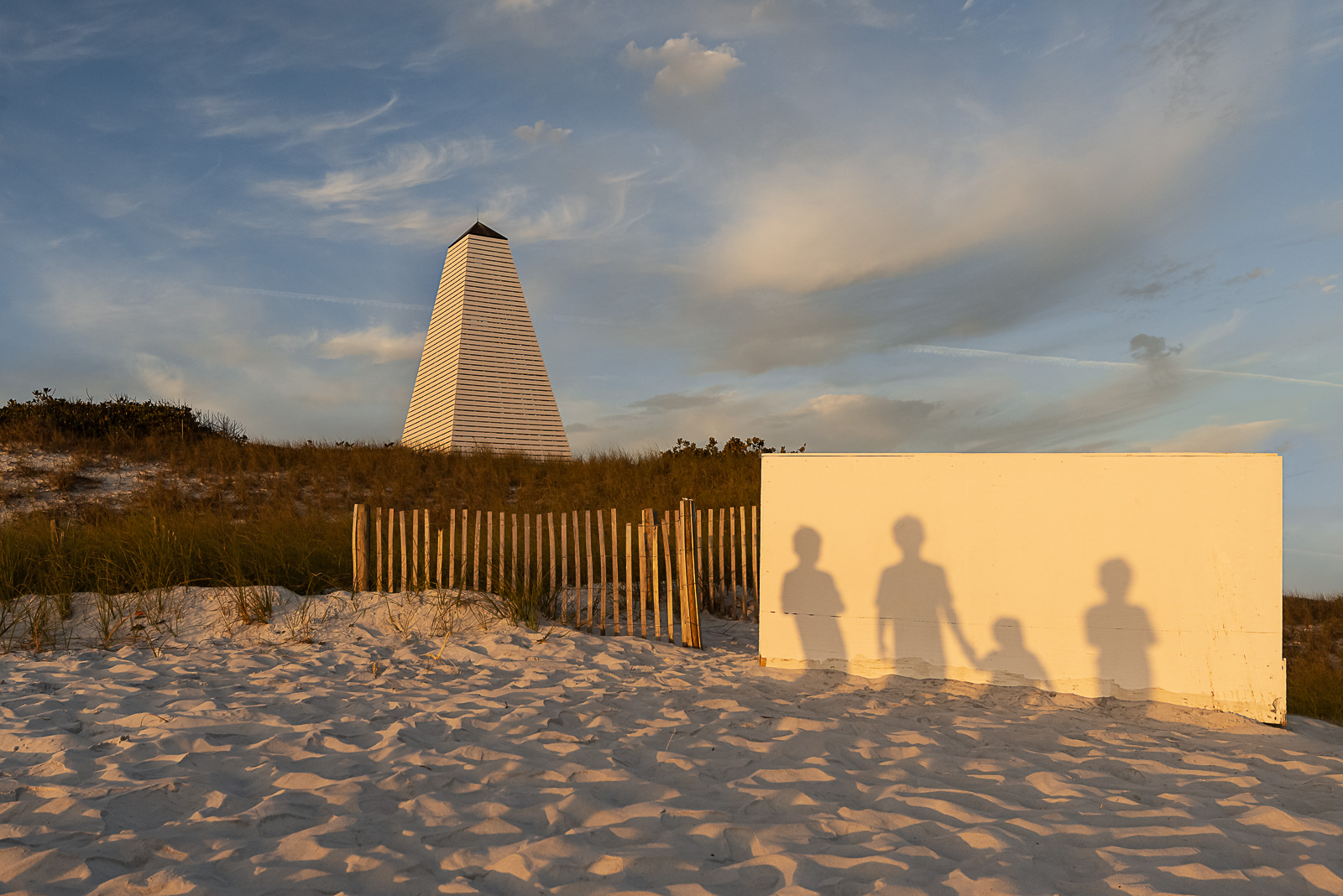 shadows of people on wall in sunset light megan arndt clickin moms member story