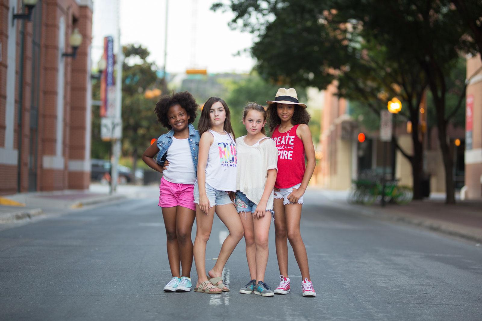 tween girls posing together in street kristina mccaleb
