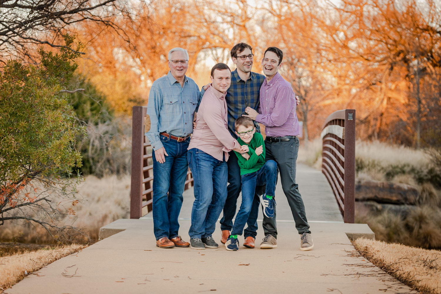 Large Group Photo Session family laughing in front of bridge by Shelly Niehaus Photography Prosper, TX.-15