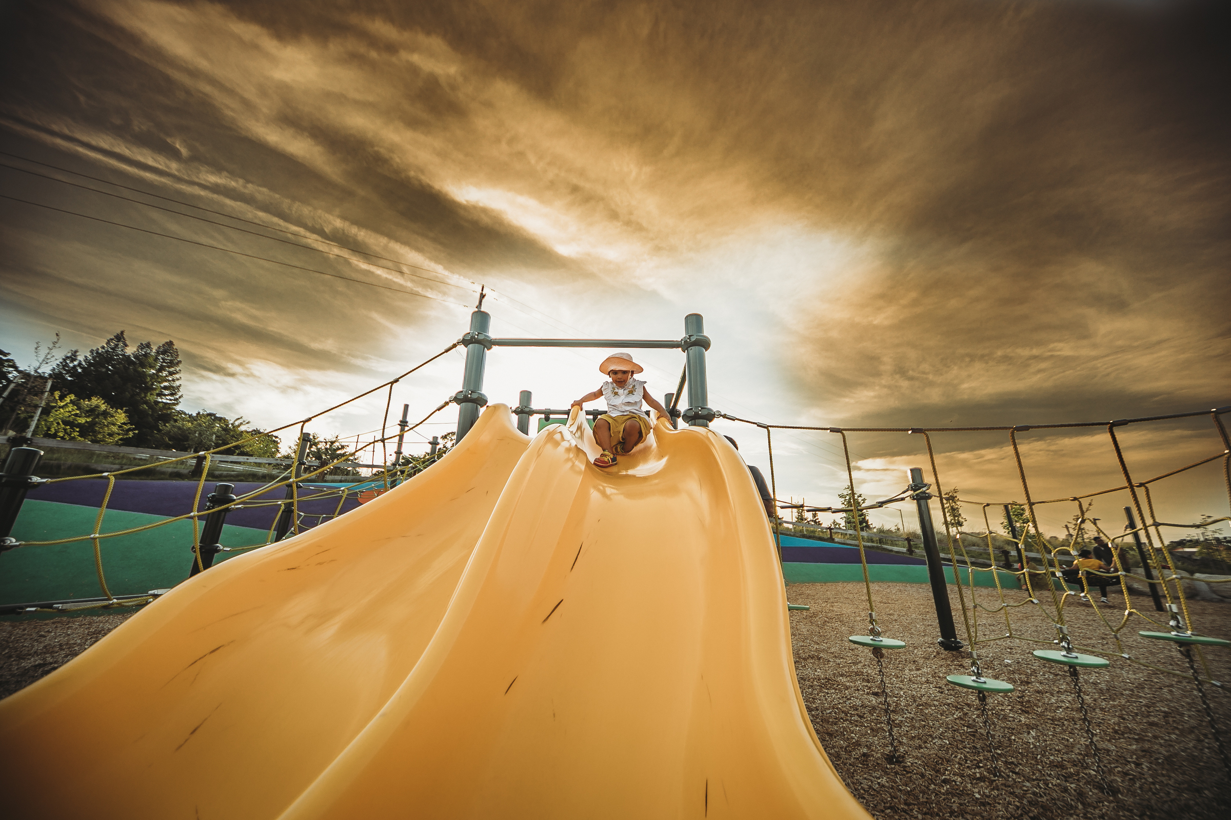 child at top of yellow slide after edit by jyo bhamidipati