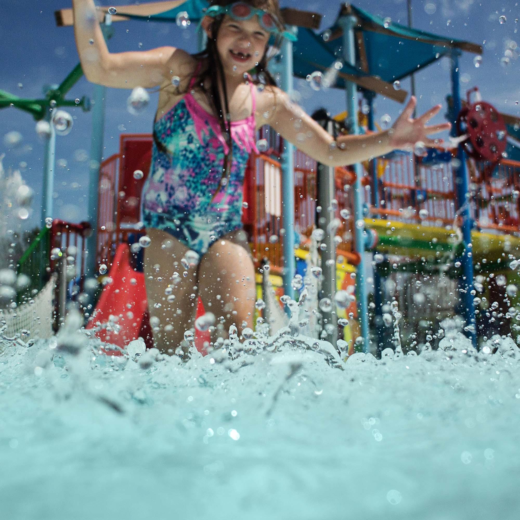 girl-splashing-in-water-kellie-bieser