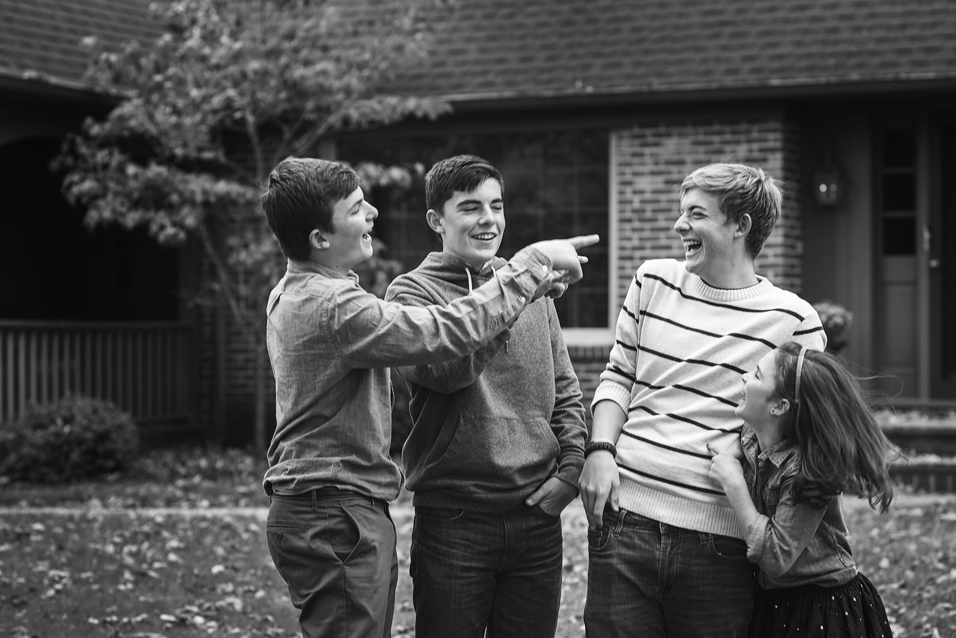 four kids laughing together black and white photo kellie bieser