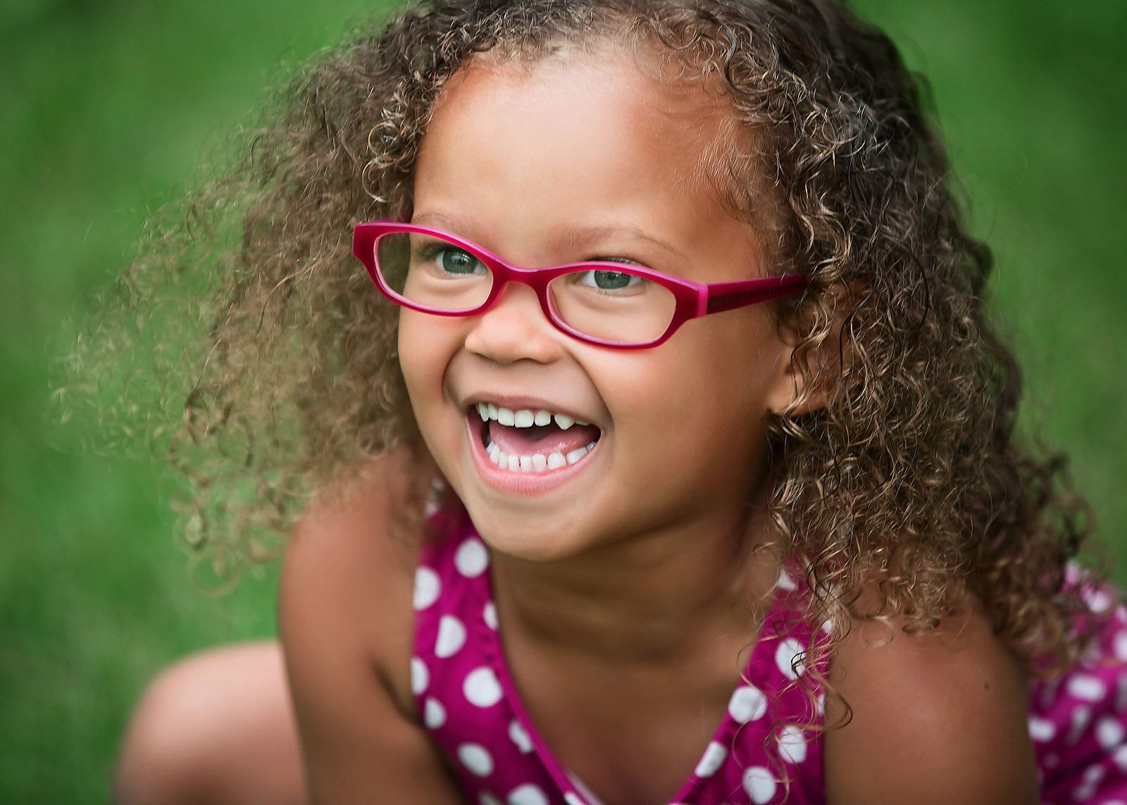 Girl In Red Glasses With Curly Hair Smiling Games For Happy