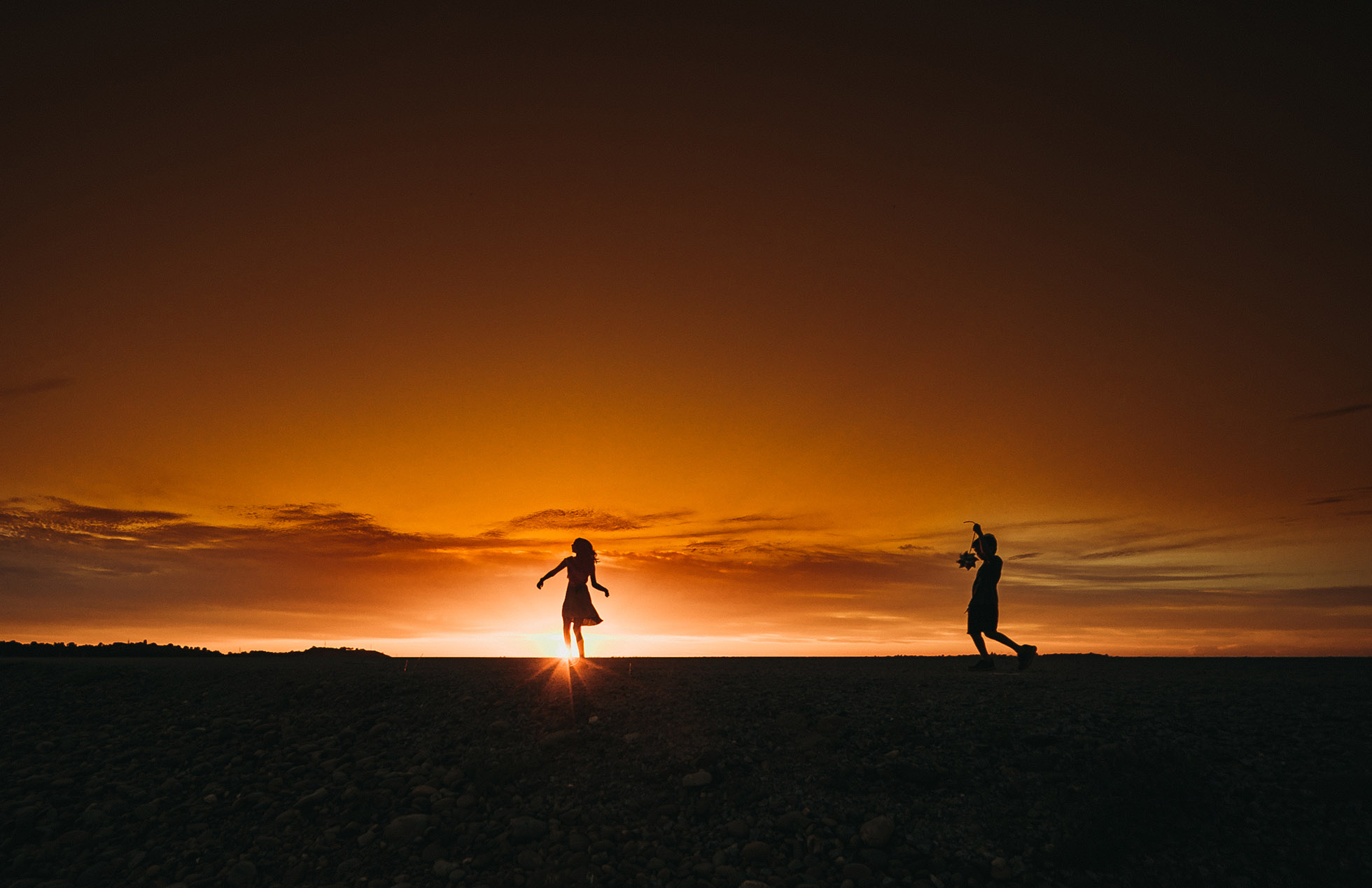 silhouettes of children playing at sunset by jyo bhamidipati