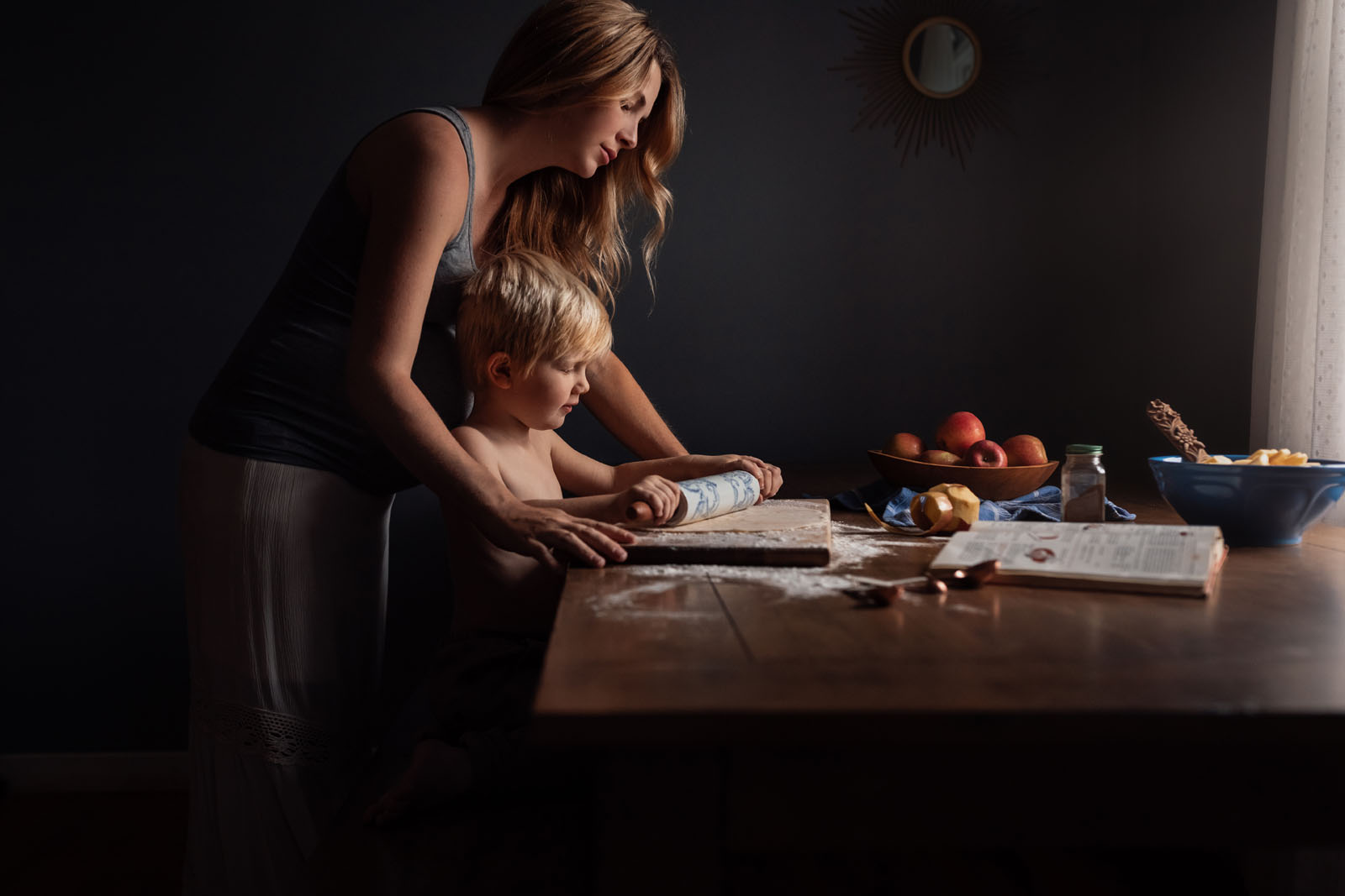 megloeks_10 mother making apple pie with small boy fall activities by meg loeks