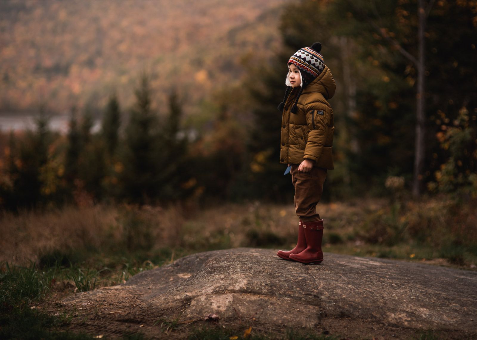 photographing fall color boy in coat and hat and boots sarah gupta