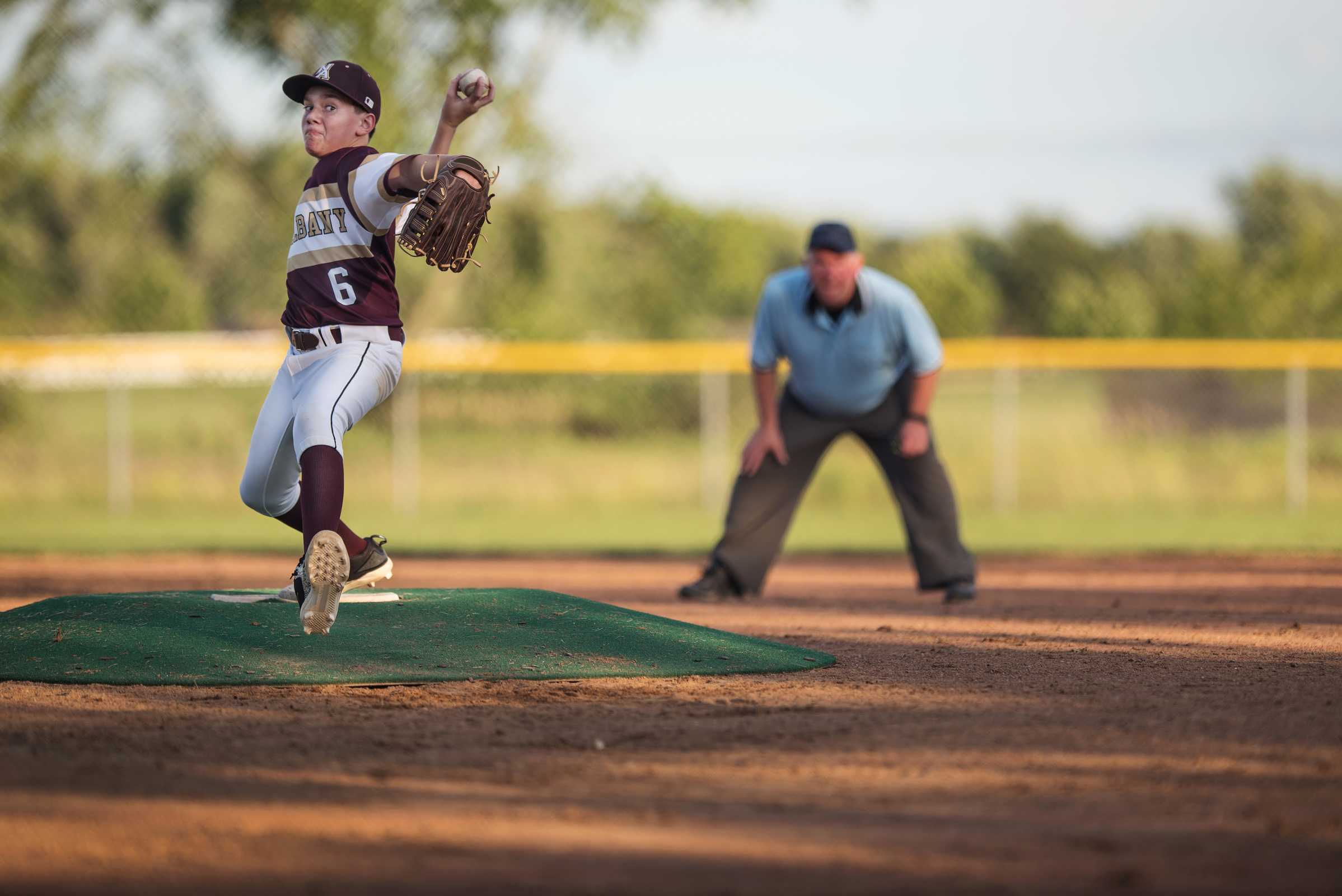 photographing kids sports boy throwing baseball pitcher by kellie bieser