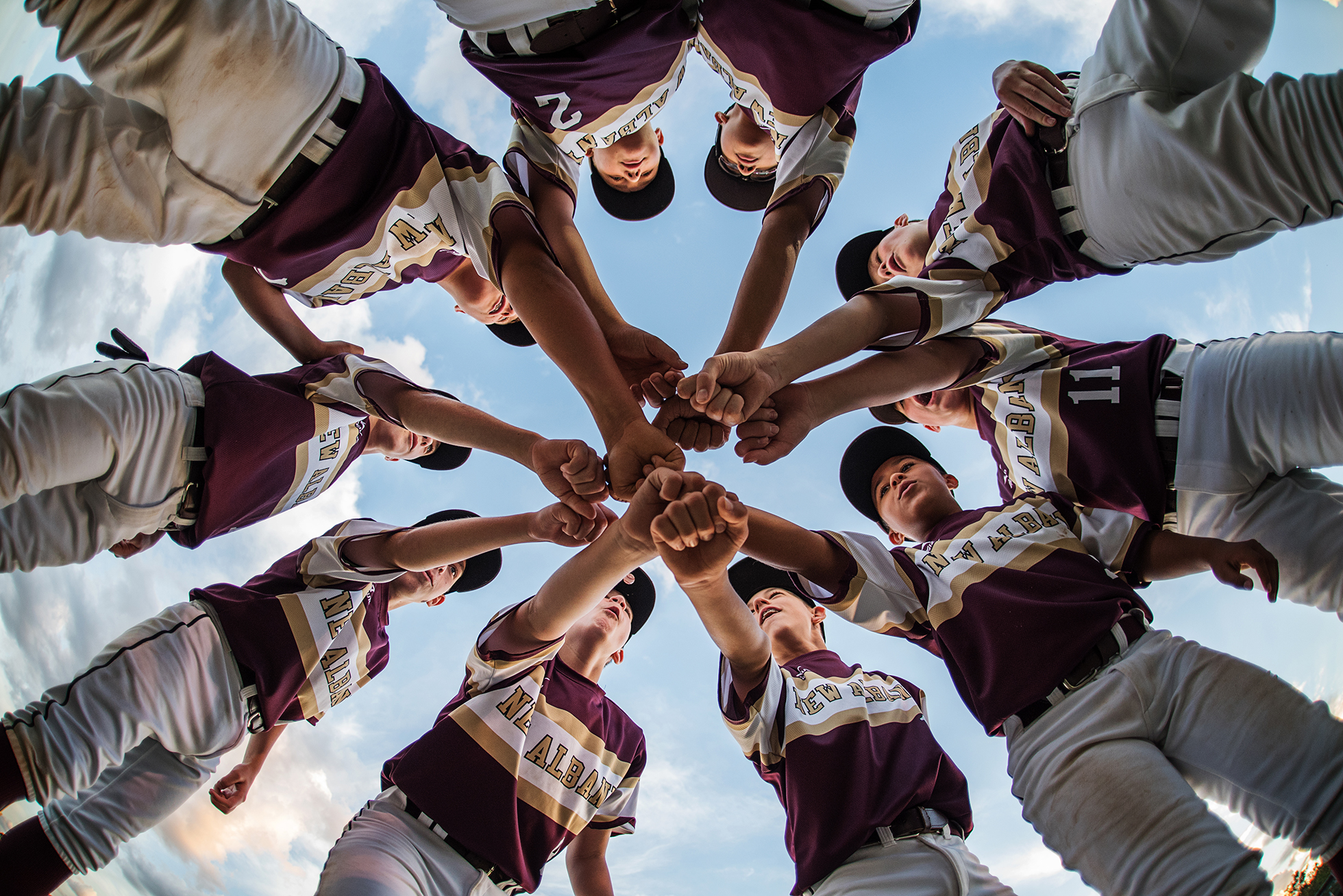 photographing kids sports low perspective of baseball team huddle by kellie bieser