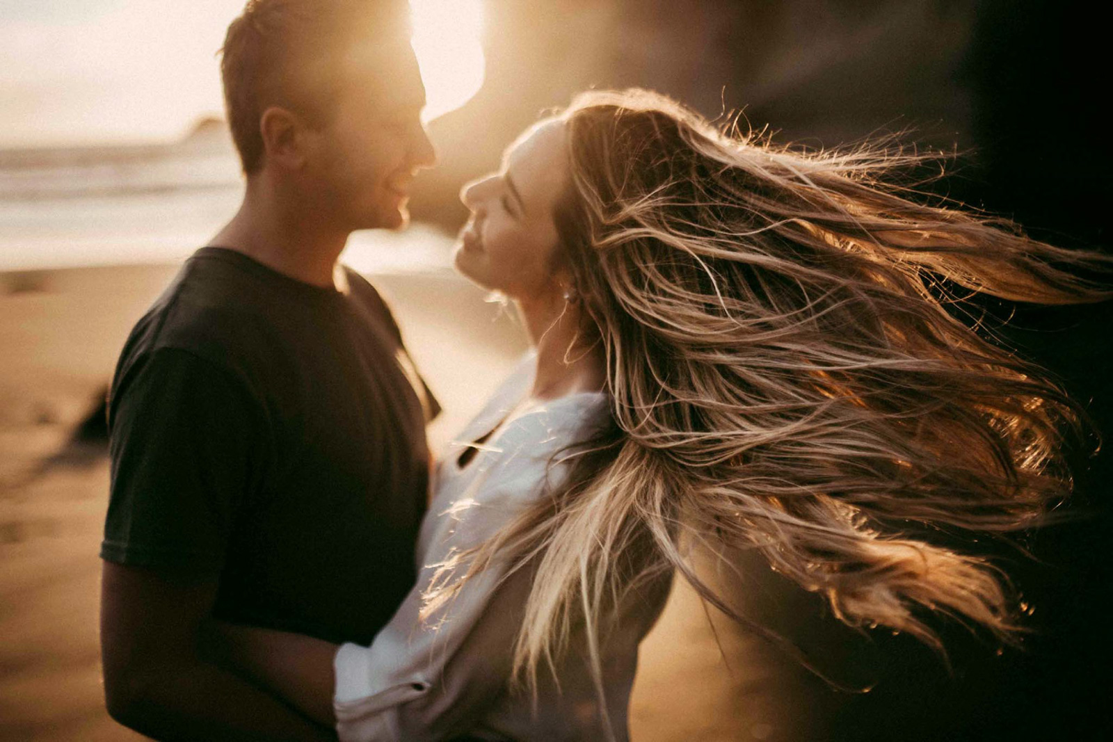 how-to-speed-up-workflow-man and woman on beach hair flowing golden hourby-Olga Levien-3
